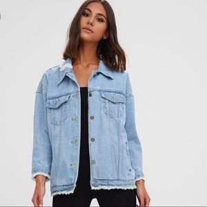 Light wash denim jacket with distressed sleeves